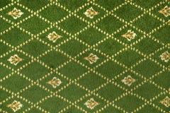 Frammento del modello decorativo del tessuto del tappeto Fotografia Stock Libera da Diritti