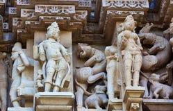 Frammento del tempiale erotico famoso in Khajuraho Fotografia Stock
