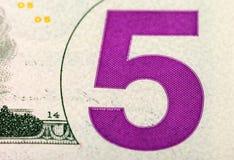 Frammento della banconota da cinque dollari Fotografie Stock