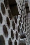 Frammento della parete con i fori Fotografia Stock