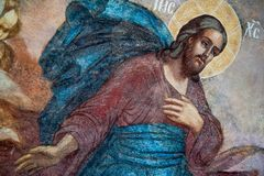 Frammento della pittura murala di Jesus Christ in Tolga Monastery fotografia stock libera da diritti