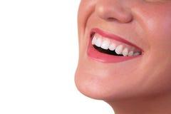 Frammento di sorriso del fronte del `s della donna Fotografie Stock