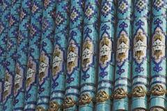 Frammento di una parete coperta di tegoli fotografia stock libera da diritti