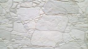 Frammento di una parete fatta dalle pietre bianche fotografia stock libera da diritti