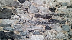 Frammento di una parete fatta dalle pietre fotografia stock libera da diritti