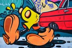 Frammento di vecchia parete con la pittura variopinta dei graffiti immagini stock libere da diritti