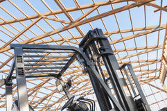 Framming of new barn under construction and forklift Royalty Free Stock Image