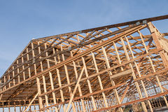 Framming of a new barn under construction. The framming of a new barn under construction with a section of metal roof installed Stock Photos
