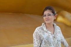 Framsida av gammala asiatiska år för kvinna 45s med inget smink Arkivbild