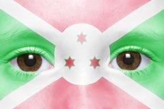 Framsida med den Burundi flaggan royaltyfri foto