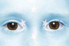 Framsida med den Federated States of Micronesia flaggan royaltyfria bilder