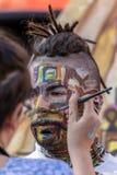 Framsida- och kroppmålning av en man Fotografering för Bildbyråer