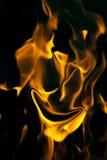 Framsida på brand på en svart bakgrund royaltyfria bilder