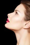framsidakvinnlign gör den model perfekta sidan upp sikt Royaltyfri Fotografi