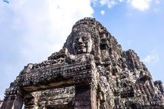 Framsidatorn av Buddha i den Bayon templet Fotografering för Bildbyråer