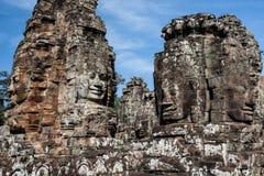 Framsidor av Angkor Thom - Cambodja arkivbilder