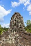 Framsidor av det Bayon tempelet Arkivbilder