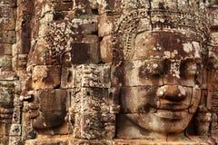 Framsidor i den Bayon templet, Angkor Wat, Cambodja Fotografering för Bildbyråer