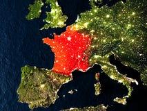 França no vermelho do espaço na noite Imagem de Stock Royalty Free