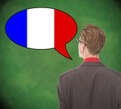 Francês falador novo do homem de negócio na administração da escola Imagens de Stock
