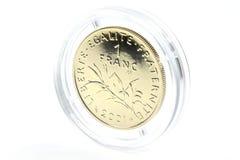 1 franc guld- mynt Fotografering för Bildbyråer