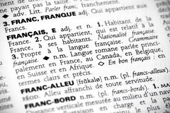 Francais in the dictionary. Macro shot with focus on the word francais and its definition in a french dictionary Royalty Free Stock Image