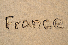 France. Written on a sandy beach Stock Images
