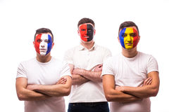 France, Albania, Romania Football fans of national teams with crossed hand look at camera Stock Photos