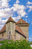 Detail of a tall tower of the castle of Annecy. Royalty Free Stock Photo