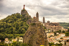 France, Auvergne, Le Puy en Velay. The city and Saint-Michel d'Aiguilhe church Royalty Free Stock Photography