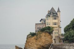 FRANCE, BIARRITZ - SEPTEMBER 18, 2018: Beautiful modern castle situated by the sea with cliffs. Against the grey sky royalty free stock photo