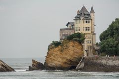 FRANCE, BIARRITZ - SEPTEMBER 18, 2018: Castle situated by the sea with cliffs on a grey day. FRANCE, BIARRITZ - SEPTEMBER 18, 2018: Castle situated by the sea stock photo