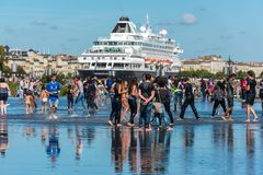 Famous dutch cruise ship Prinsendam in Bordeaux, France. FRANCE, BORDEAUX - SEPTEMBER 20: Young people having fun and Famous dutch cruise ship Prinsendam in Stock Images