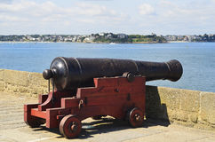 France, Brittany, Saint Malo. Medieval cannon and view to Dinard Stock Images