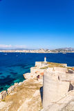 France. Castle and lighthouse on the island of If. In the background, Marseille Royalty Free Stock Image