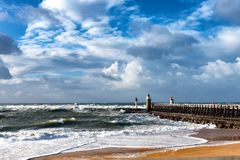 France coast-Capbreton, wooden jetty. France coast, Capbreton, wooden jetty with lighthouse Royalty Free Stock Photos