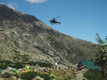France, Corsica, Corsician Alps, June 19, 2017: helicopter dropping off supplies for mountain camp Refuge de Pietra Piana on royalty free stock photo