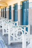Beach closets with famous names in Deauville, France. FRANCE, DEAUVILLE - SEPTEMBER 27: original beach closets with famous names on promenade Des Planches in stock images