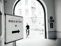 France; election; campaign; candidate; candidates; citizen; demo. Bureau de vote sign in French city with people goying to pooling place during the second round Royalty Free Stock Photo