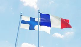 Two waving flags. France and Finland, two flags waving against blue sky. 3d image Stock Photography