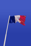 France flag. In a blue sky Royalty Free Stock Photos