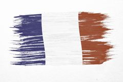 France flag. Art brush watercolor painting of France flag blown in the wind isolated on white background Royalty Free Stock Photography