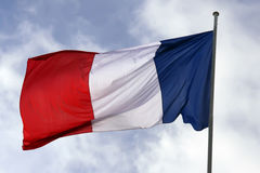 France, flag. France flag , blowing in the wind, blue sky Stock Photos