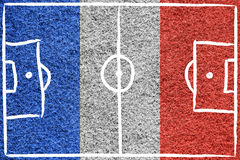 France flag with hand drawn soccer field. Hand drawn (sketch style) soccer field or football field on France flag colored grass background Royalty Free Stock Photo
