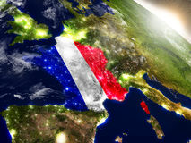 France with flag in rising sun Stock Photo