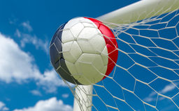 France flag and soccer ball in goal net Stock Photos