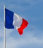 France flag. Is waving in front of blue sky royalty free stock images