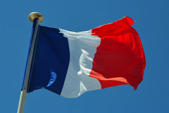 A France flag. Flag of France, waving in the wind, on the sky Royalty Free Stock Image