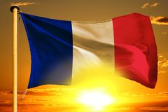 France flag weaving on the beautiful orange sunset with clouds background. France flag weaving on the beautiful orange sunset background stock photos
