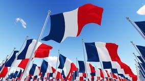 France Flags on flagpoles against blue sky. Stock Photos